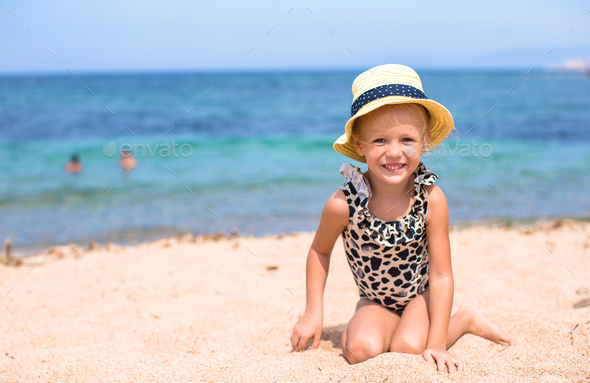 Adorable little girl have fun at tropical beach - Stock Photo - Images