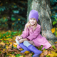 Little happy girl in autumn park on sunny fall day - PhotoDune Item for Sale