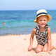 Adorable little girl have fun at tropical beach - PhotoDune Item for Sale