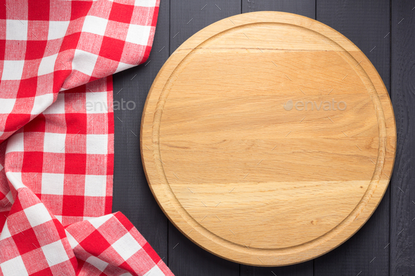 pizza cutting board at rustic wooden plank board background - Stock Photo - Images