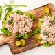 Flat lay view at homemade tuna salad sandwiches on cutting board with pickles aside - PhotoDune Item for Sale