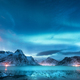 Aurora borealis over the sea coast, snowy mountains and city - PhotoDune Item for Sale
