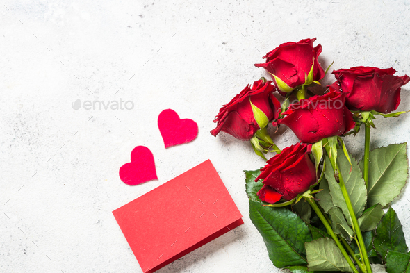 Valentines day background. Red roses, hearts and present on white - Stock Photo - Images