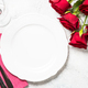 Romantic holiday table setting with plate, roses and present - PhotoDune Item for Sale