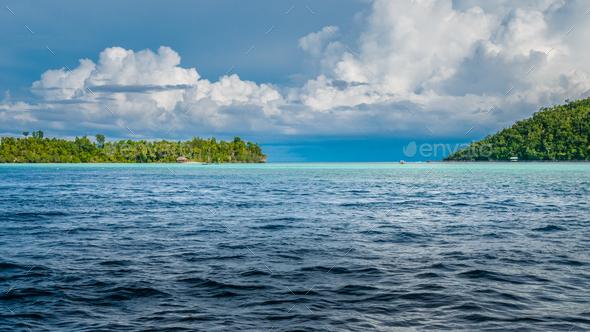 Strait between Kri and Monsuar Island. Raja Ampat, Indonesia, West Papua - Stock Photo - Images