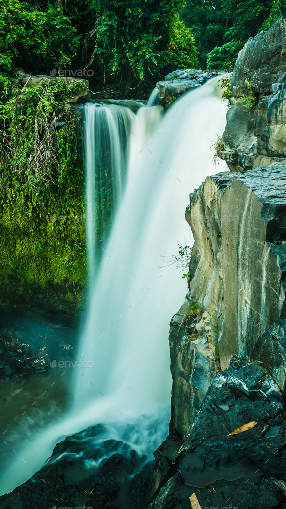 Close up of Tegenungan Waterfall near Ubud in Bali, Indonesia - Stock Photo - Images
