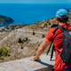 Male summer holiday vacation on Kefalonia Greece. Photographer with backpack enjoying capture of - PhotoDune Item for Sale