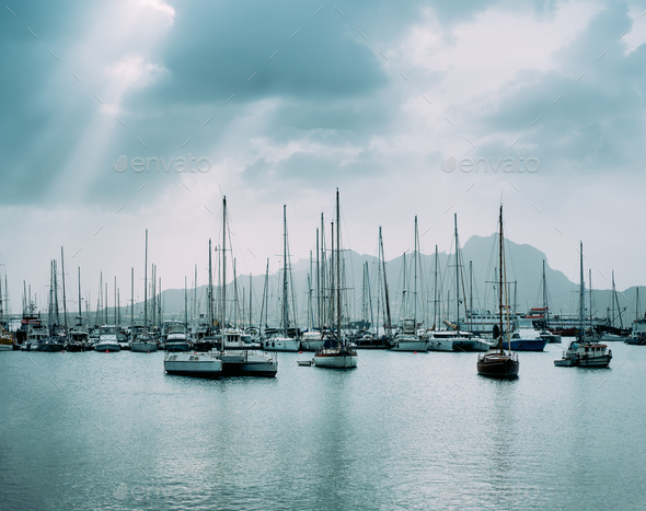 Sailboats and pleasure boats in the porto grande bay of the historic city Mindelo. Clodscape with - Stock Photo - Images