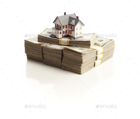 Small House on Stacks of Hundred Dollar Bills - Stock Photo - Images