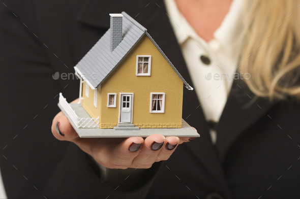 House in Female Hand - Stock Photo - Images