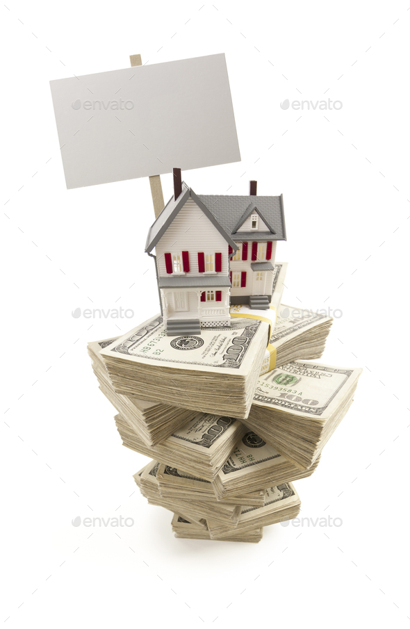Small House on Stacks of Hundred Dollar Bills and Blank Sign - Stock Photo - Images