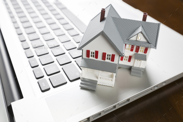 Miniature House on Laptop Computer - Stock Photo - Images