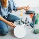 Female house painter mixes paints in pail - PhotoDune Item for Sale