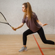 Female player with squash racket in action - PhotoDune Item for Sale