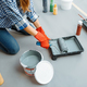 House painter impregnates the roller with paint - PhotoDune Item for Sale