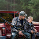 Hunter with his son during the rest sitting inside the pickup truck - PhotoDune Item for Sale