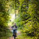 A young boy riding his bike in a summer forest - PhotoDune Item for Sale