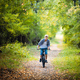 Boy riding a bike outdoors in the grass on a sunny day with hands raised - PhotoDune Item for Sale
