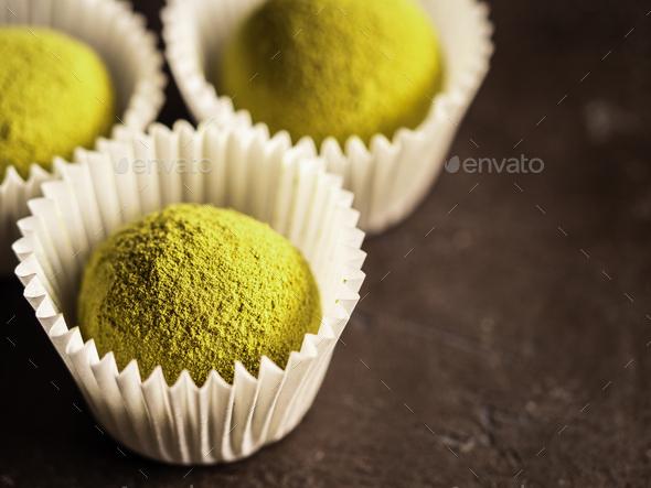 Homemade truffles with matcha tea powder,copyspace - Stock Photo - Images