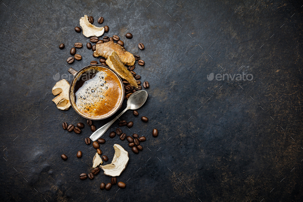 Mushroom Chaga Coffee Superfood Trend-dry and fresh mushrooms and coffee beans on dark background - Stock Photo - Images