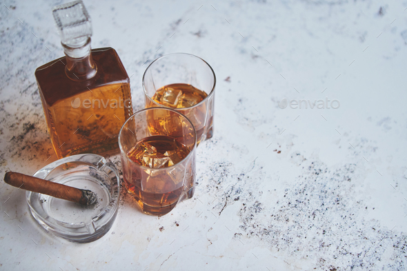 Bottle and glasses of brandy or wiskey and nice big cuban cigar - Stock Photo - Images