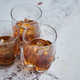 Three glasses filled with ice cubes and old aromatic whiskey - PhotoDune Item for Sale