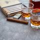 Carafe of Whiskey or brandy, glasses and box of finnest Cuban cigars - PhotoDune Item for Sale