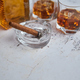 Bottle and glasses of brandy or wiskey and nice big cuban cigar - PhotoDune Item for Sale