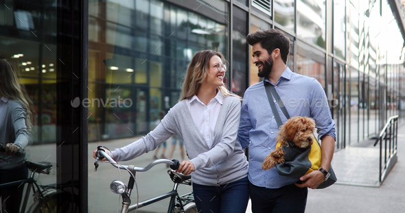 Romantic couple is having rest in the city with dog - Stock Photo - Images