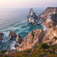 Sintra, Portugal. Praia da Ursa or Ursa Beach impressive unique sea stacks and cliffs in evening - PhotoDune Item for Sale