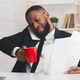 Stressed manager drinking coffee at job, talking by phone - PhotoDune Item for Sale