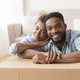 Afro Spouses Embracing Among Unpacked Moving Boxes In New Flat - PhotoDune Item for Sale