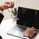 Cropped image of businessman using laptop with blank screen - PhotoDune Item for Sale