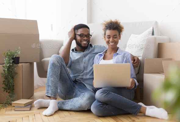Happy Couple Using Laptop Sitting On Floor In New Home - Stock Photo - Images
