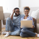 Happy Couple Using Laptop Sitting On Floor In New Home - PhotoDune Item for Sale