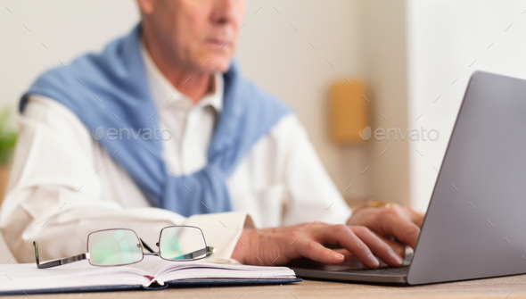 Unrecognizable Senior Businessman Working On Laptop Sitting In Office, Cropped - Stock Photo - Images