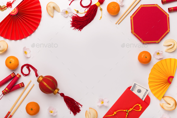 Chinese New Year decorations creating frame on white - Stock Photo - Images