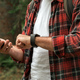 Hiker connecting smartwatch to smartphone to synchronize the data - PhotoDune Item for Sale