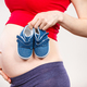 Pregnant woman with baby shoes, expecting for baby - PhotoDune Item for Sale