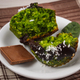 Fresh muffins with spinach, desiccated coconut and chocolate glaze, delicious healthy dessert - PhotoDune Item for Sale