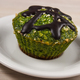 Fresh muffin with spinach, desiccated coconut and chocolate glaze, delicious healthy dessert - PhotoDune Item for Sale