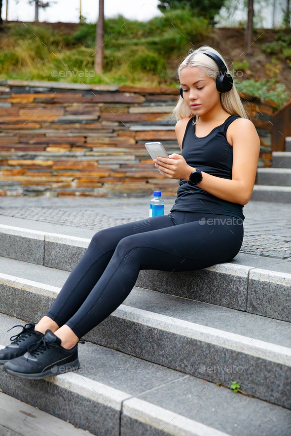 Sporty Young Woman Listening Music With Headphones And Smartphone - Stock Photo - Images