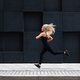 Fit young woman running in minimalist urban city environment - PhotoDune Item for Sale