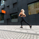 Back view of a fast running fit woman in modern city environment - PhotoDune Item for Sale