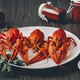 Three boiled fresh crawfish in white plate with green herbs - PhotoDune Item for Sale
