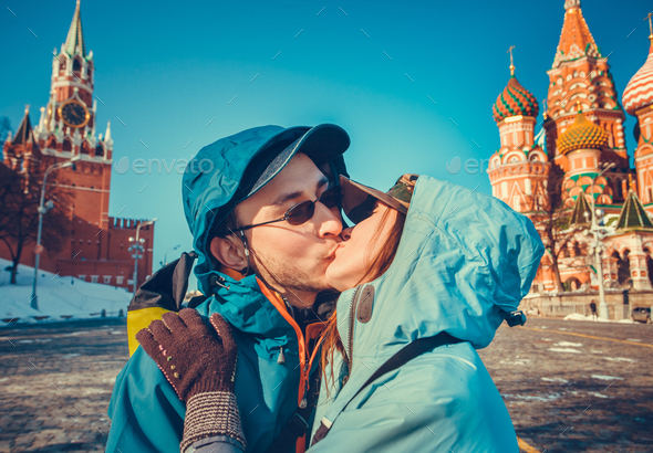 Happy tourists kissing on Red Square, Moscow - Stock Photo - Images