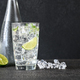 Glass of sparkling water with ice cubes and slice of lime - PhotoDune Item for Sale
