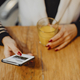 Woman having a glass of juice and checking her phone - PhotoDune Item for Sale