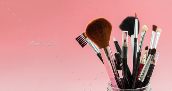 Make-up brushes set against red background, copy space - Stock Photo - Images