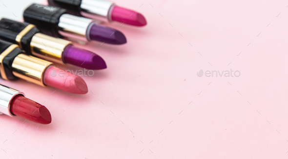 Lipsticks various colors against pink background, closeup view - Stock Photo - Images